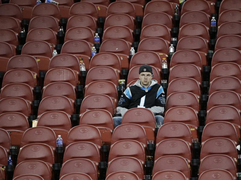 A Carolina Panthers fan sits in the stands after the NFL Super Bowl 50 football game. (AP Photo)
