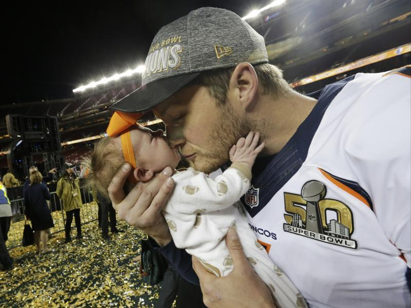Denver Broncos' Britton Colquitt kisses his daughter Isla after the NFL Super Bowl 50. (AP Photo)
