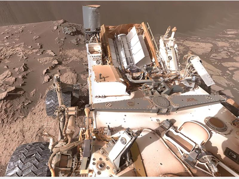 Even the rover poses with its shiny wheels and metal shell that seem to be taking a beating on the harsh conditions Mars is subjecting it to. (Youtube)