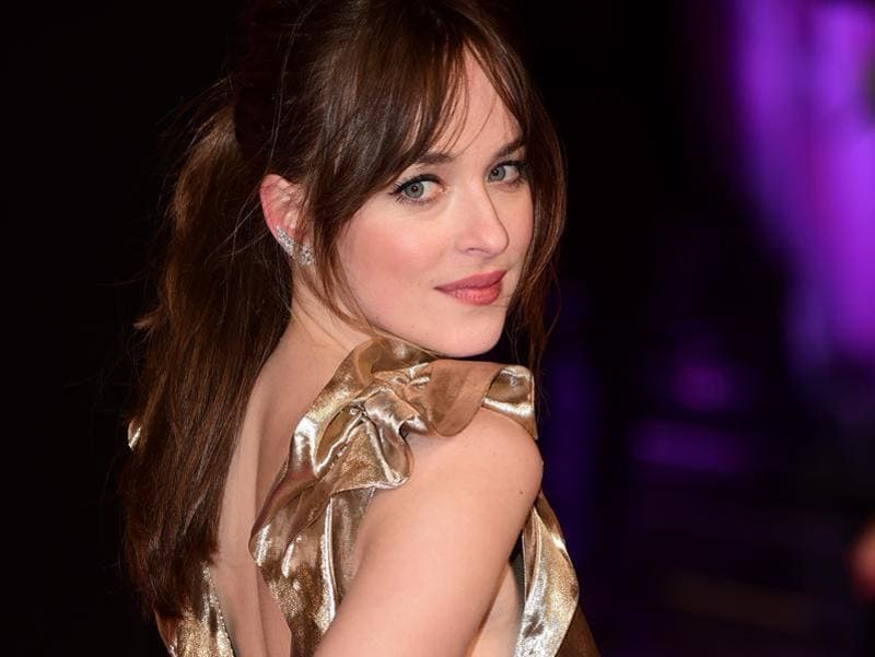 Dakota Johnson shimmers at the red carpet premiere of How To Be Single in London.  (AFP)