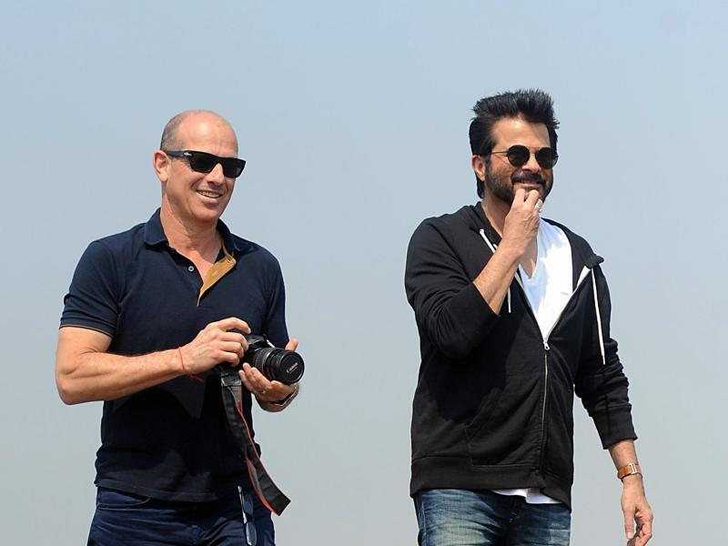US television writer and producer Howard Gordon and Anil Kapoor walk on location for the Hindi version of the hit TV show 24 as season 2 is being made, in Mumbai. (AFP)