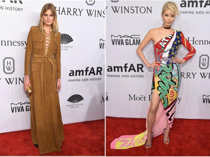 Models Constance Jablonski and Soo Joo Park are visions in contrasting outfits at the amfAR red carpet in New York. (AFP)