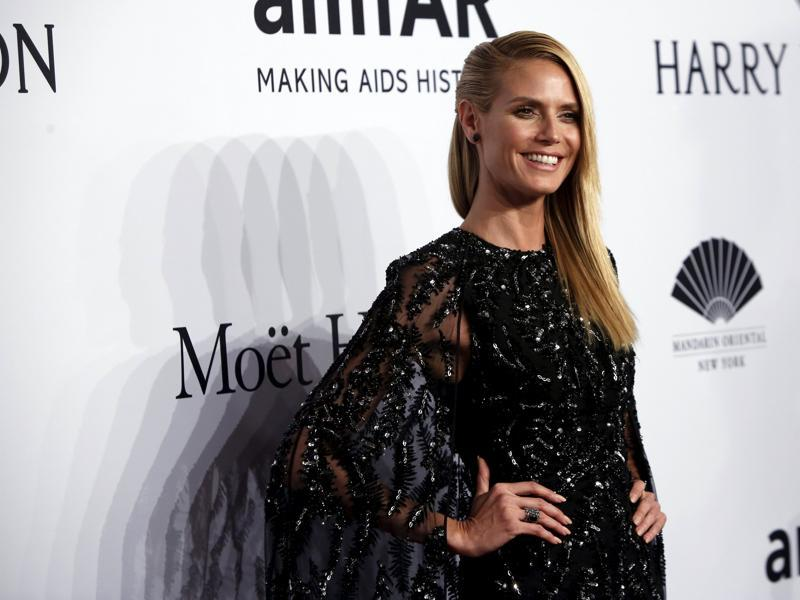 Supermodel Heidi Klum shimmers in black at the 2016 amfAR New York Gala. (REUTERS)