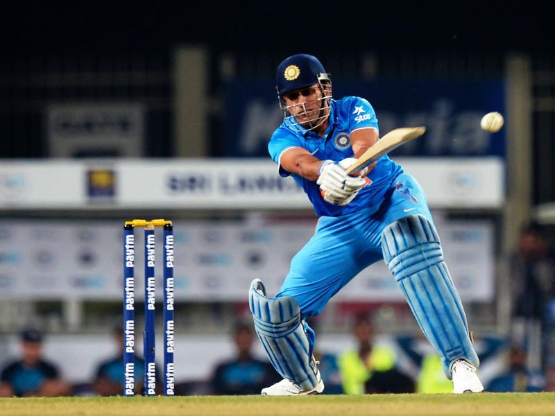 India's T20 cricket captain Mahendra Singh Dhoni plays a shot. (AFP Photo)