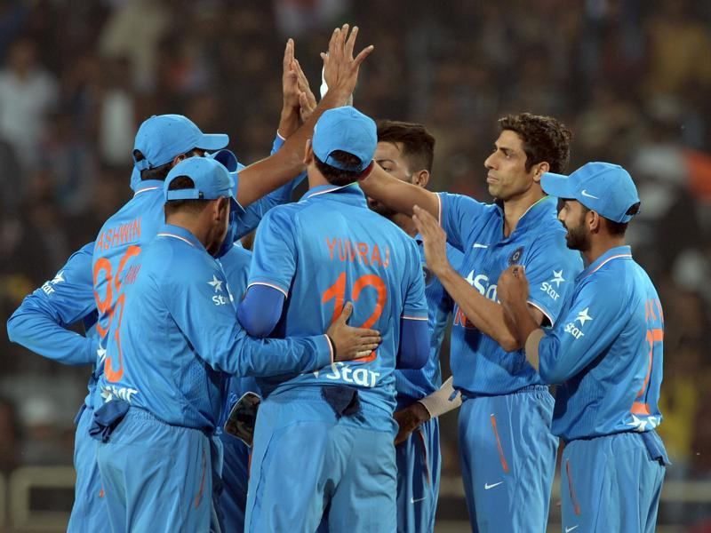 India's Ashish Nehra with teammates celebrate after taking the wicket of Sri Lanka's Danushka Gunathilaka. (AFP Photo)