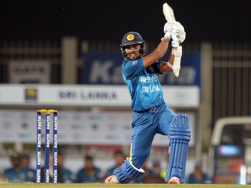Sri Lanka's T20 cricket captain Dinesh Chandimal plays a shot. (AFP Photo)