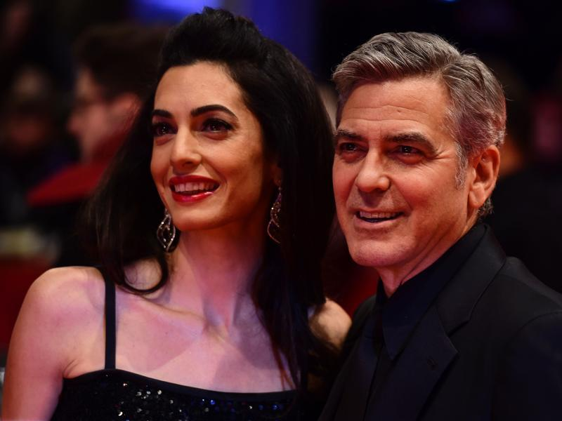 As US actor George Clooney (R) and his wife Amal Alamuddin pose for photographers the 66th Berlinale Film Festival in Berlin, it is clear that camera just loves Clooney -- we mean the wife.  (AFP)