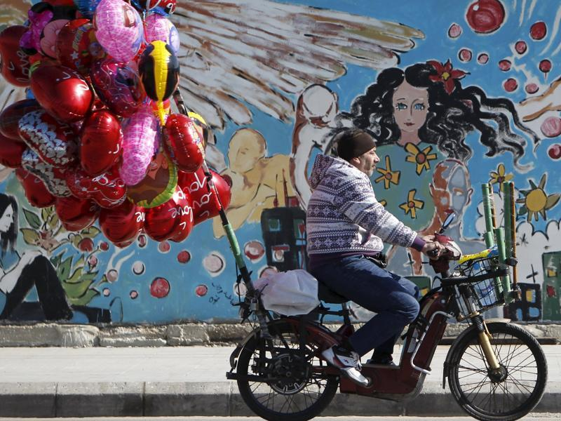 A street vendor sells heart-shaped balloons as he rides a motorbike ahead of Valentine's Day in Sidon, southern Lebanon February 12, 2016. (REUTERS)
