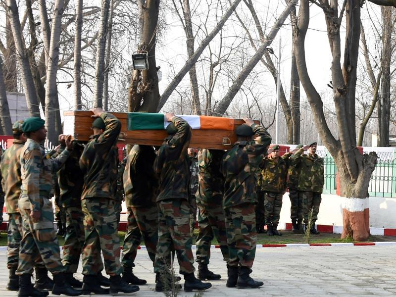 Army soldiers carrying the coffins of the soldiers, who were martyred in the Kupwara encounter, during a wreath-laying ceremony in Srinagar on Sunday.  (Waseem Andrabi/ HT)