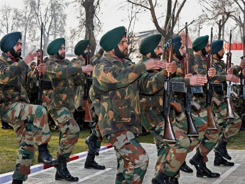 Soldiers paying tributes to two army Jawans during  the wreath-laying ceremony in Srinagar on Sunday. (PTI PHOTO)