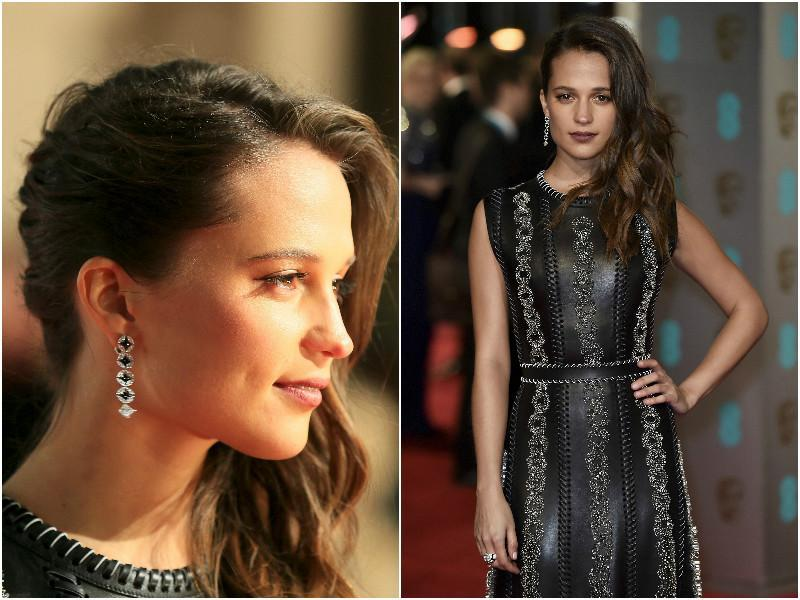 Alicia Vikander looked stunning and powerful in her black gown. Do not miss the gorgeous earrings. (Agencies)