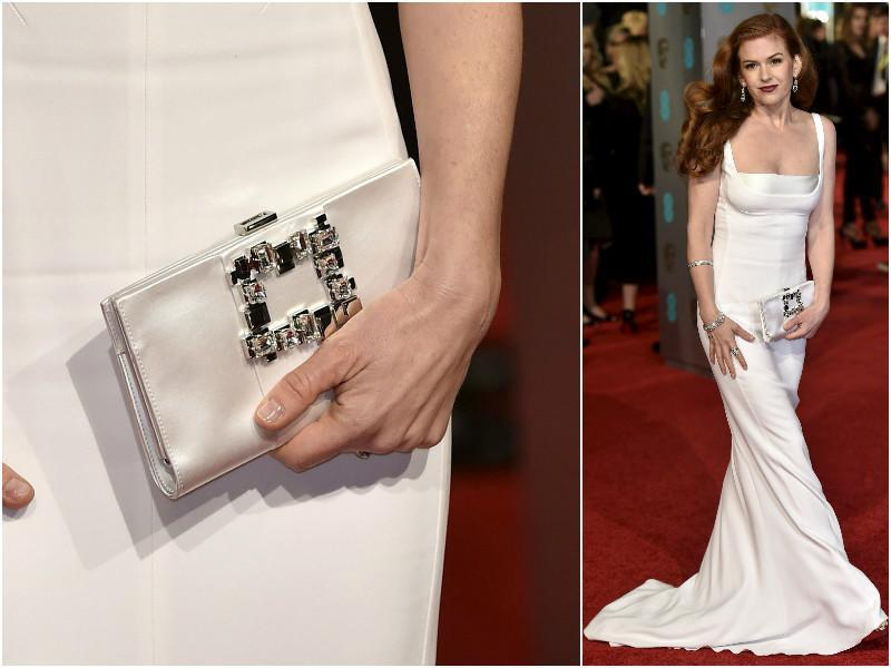Isla Fisher in a dreamlike white gown. Check out her matching petite clutch. (Agencies)