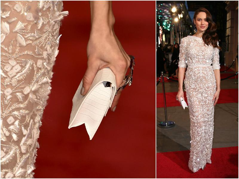 Olga Kurylenko in a sheer, sequined dress with a complimenting clutch. (Agencies)