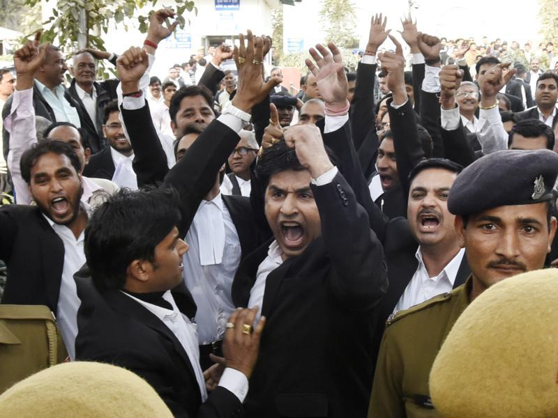 Lawyers inside the Patiala House Court premises allegedly thrashed protesters and journalists on Monday afternoon who had gone to attend the bail hearing of JNU students' union president Kanhaiya Kumar, who was arrested on charges of sedition for the Afzal Guru event.  (Sonu Mehta/HT Photo)