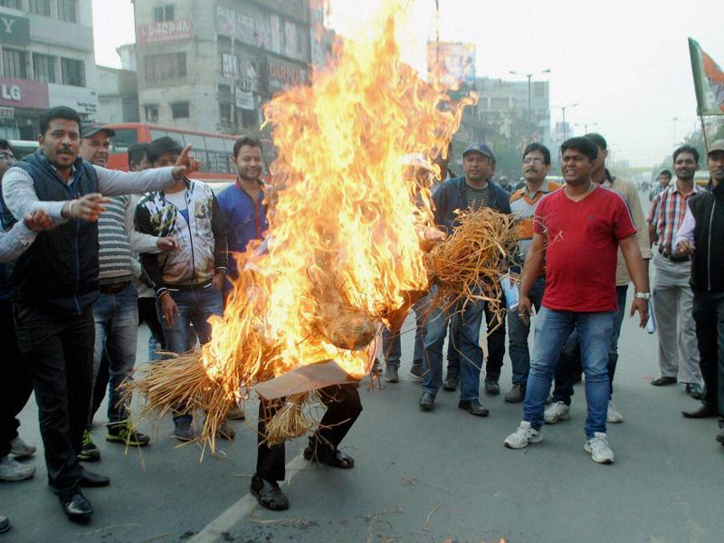 In Assam, activists of BJP burn an effigy of Congress vice president Rahul Gandhi on Monday who showed his support to the JNUSU over the Afzal Guru event . (PTI)