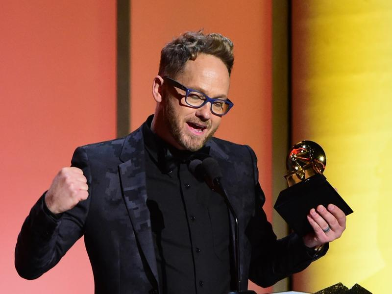 Christian hip-hop artist Tobymac receives the award for the Best Contemporary Christian Music Album, This Is Not A Test, onstage during the 58th Annual Grammy music Awards. (AFP)