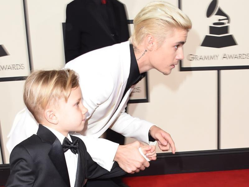 GOOD: Justin Bieber and his brother Jaxon raced on the Grammys red carpet. We don't know who won but for the sheer moment and Justin's facial fuzz, we like. (AFP)