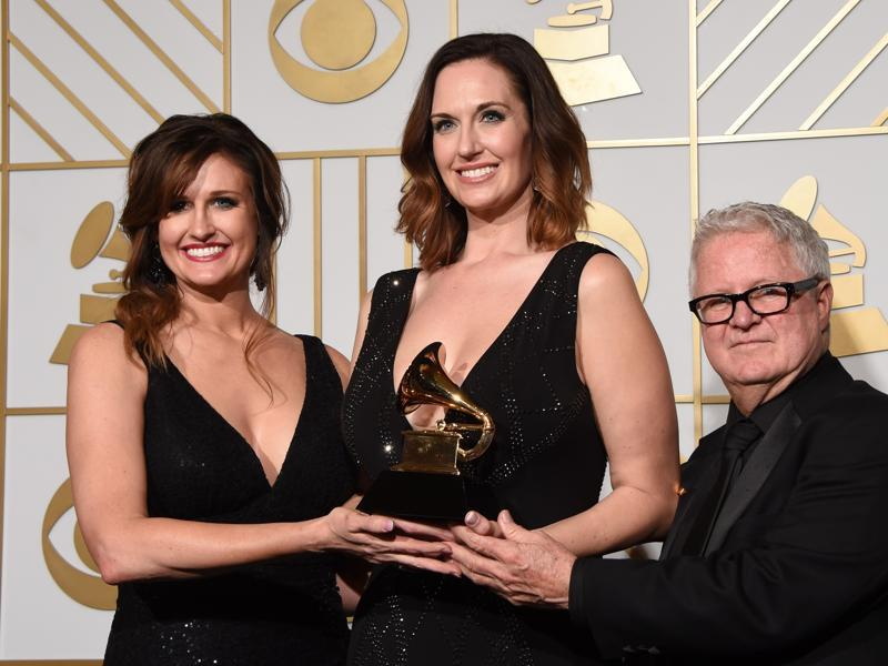Art directors Saran Dodds, Shauna Dodds and Dick Reeves pose with the trophy fo Best Recording Package Still The King in the press room during the 58th Annual Grammy Music Awards in Los Angeles on February 15.  (AFP)