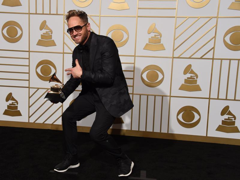 Tobymac poses with his Best Contemporary Christian Music Album This is Not A Test in the press room during the 58th Annual Grammy Music Awards in Los Angeles.  (AFP)