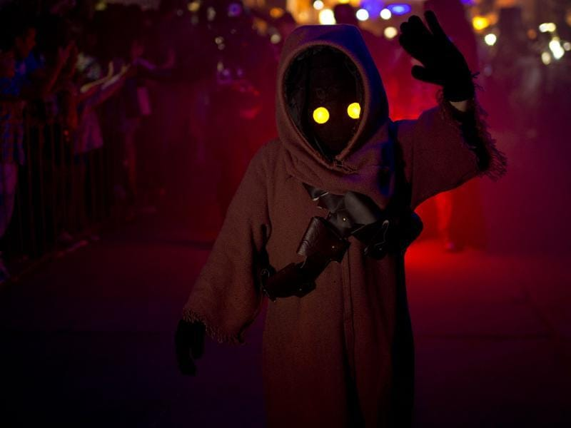 In this Feb. 14, 2016 photo, a youth sporting a Star Wars costume parades at the annual Alien Festival in Capilla del Monte, Cordoba, Argentina, the site of an alleged UFO sighting 30 years ago. Thousands of earthlings gathered for the festival in this central Argentine town which has become a global hot spot for UFO sightings. (AP Photo/Natacha Pisarenko) (AP)
