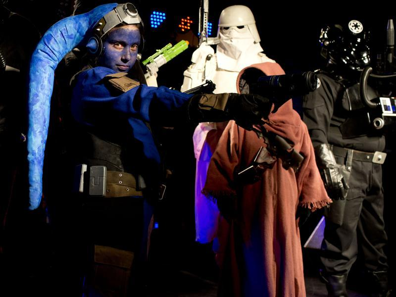 In this Feb. 14, 2016 photo, people dressed as Star Wars characters pose for pictures after parading at the annual Alien Festival in Capilla del Monte, Cordoba, Argentina, the site of an alleged UFO sighting 30 years ago. The festival, now in its fourth year, has become popular among alien enthusiasts worldwide. (AP Photo/Natacha Pisarenko) (AP)