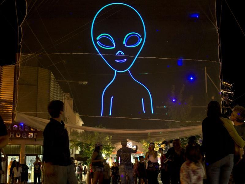 "In this Feb. 13, 2016 photo, an outline of an alien stands high during the annual Alien Festival in Capilla del Monte, Cordoba, Argentina, the site of an alleged UFO sighting 30 years ago. ""People come here for the energy, for the UFO sightings,"" said Leonardo Fuentes, a 39-year-old tourist from Chile. (AP Photo/Natacha Pisarenko) (AP)"