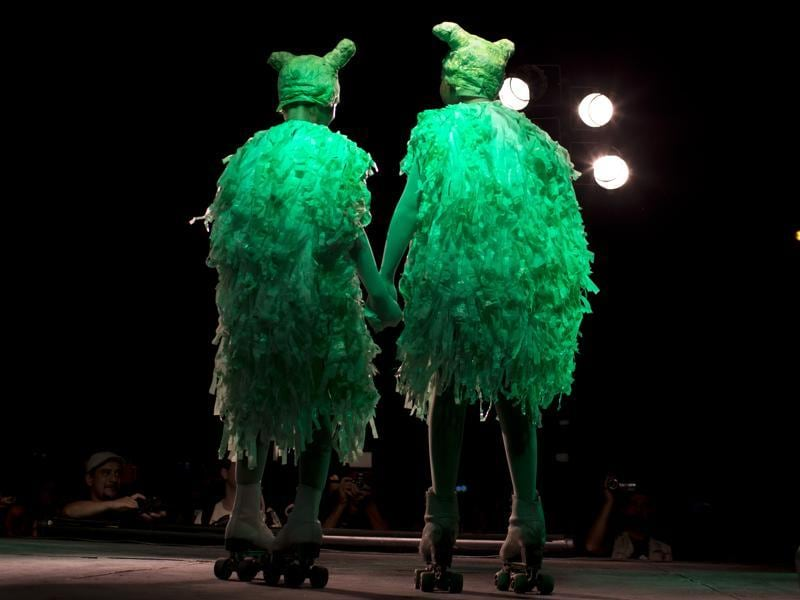 In this Feb. 12, 2016 photo, women dressed as aliens on rollers-skates stand on stage to compete in the alien costume contest in Capilla del Monte, Cordoba, Argentina, the site of an alleged UFO sighting 30 years ago. The festival, currently hosting its 4th edition, has caused some controversy as the more fervent believers feel it has put a frivolous twist on what they consider a serious phenomenon. (AP Photo/Natacha Pisarenko) (AP)