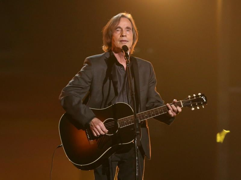 Jackson Browne performs Take It Easy during a tribute to Glenn Frey at the 58th annual Grammy Awards. (Matt Sayles/Invision/AP)