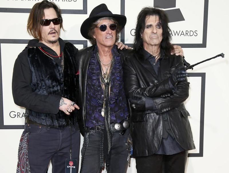 BAD: Johnny Depp thinks that outfit makes for red carpet appearance. We are just worried sick what he would wear to Oscars! Pictured here with Joe Perry and Alice Cooper. (REUTERS)