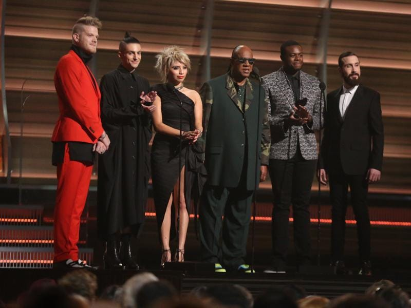 Stevie Wonder, center, and from left Scott Hoying, Mitch Grassing, Kristin Maldonado, Kevin Olusola, and Avi Kaplan of Pentatonix perform at the 58th annual Grammy Awards.  (Matt Sayles/Invision/AP)