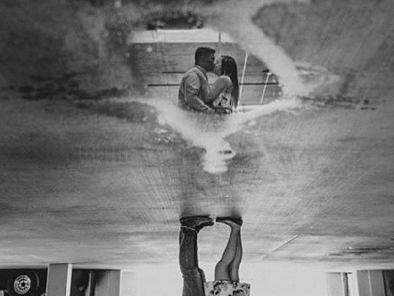 A picture posted by Californian photographer Ryan Horban. The couple is visible in the reflection  in water in this black and white upside-down picture. (Instagram/ryanhorban)