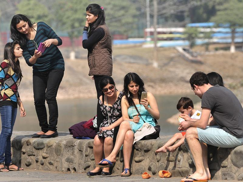 Residents enjoying  themselves  on a sunny day at Sukhna Lake in Chandigarh.   (Keshav Singh/HT )