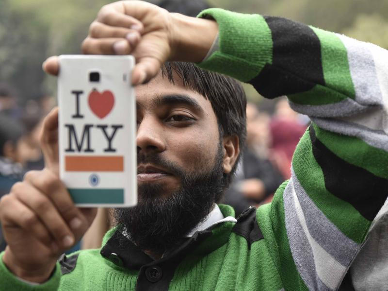 A JNU students takes a photo from his mobile phone during a march in support of JNUSU president Kanhaiya Kumar. (Vipin Kumar/HT Photo)
