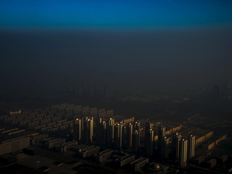 Contemporary Issues, 1st prize singles, World Press Photo Awards (Zhang Lei - Haze in China)A city in northern China is shrouded in haze, Tianjin, China, December 10, 2015. REUTERS/Zhang Lei via WPP EDITORIAL USE ONLY. NO RESALES. NO ARCHIVE (REUTERS)