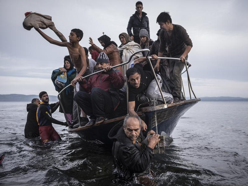 In this image released by World Press Photo titled 'Reporting Europe's Refugee Crisis' by photographer Sergey Ponomarev for The New York Times which won the first prize in the General News Stories category shows refugees arriving by boat near the village of Skala on Lesbos, Greece, 16 November 2015. (Sergey Ponomarev/ NYT/ AP)