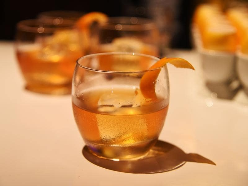 A Demure & Dashing, a Haig Club Single Grain Scotch Whisky specialty cocktail made with spiced honey syrup, Galliano Liqueur, bitters and an orange twist, is displayed at a preview of the food and décor of this year's Governors Ball, the Academy's official post-Oscar celebration. (AFP)