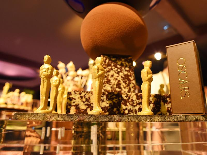 A golden leaf covered chocolate Oscar statuettes are displayed at a preview of the food and décor of this year's Governors Ball, the Academy's official post-Oscar celebration, which will follow the 88th Oscars ceremony. (AFP)