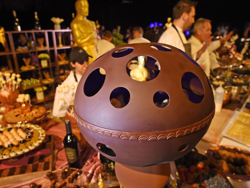 A golden leaf covered chocolate Oscar statuette enclosed in a hand-formed chocolate bubble, is displayed at a preview of the food and décor of this year's Governors Ball, the Academy's official post-Oscar celebration, which will follow the 88th Oscars ceremony. (AFP)