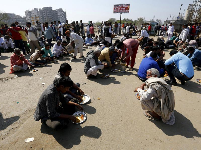 Demonstrators from the Jat community eat as they block the Delhi-Haryana national highway during a protest in New Delh. Protesters converged on major crossroads and forced highway petrol pumps across the state to shut down, amid reports that the army was forced to back down in some areas. (REUTERS)