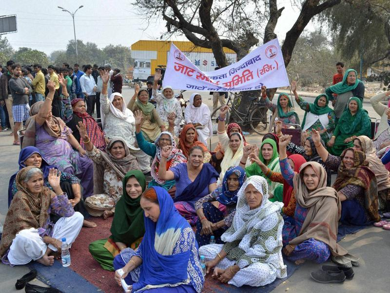 People of Jat community block the old Delhi road in Gurgaon during their agitation for reservation. Authorities clamped curfew in eight districts -- Rohtak, Bhiwani, Jhajjar, Hisar, Jind, Kaithal, Sonipat and Panipat - but angry mobs continued to run riot over large swathes of the state. (PTI)