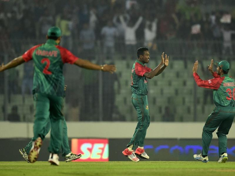 Bangladesh's Al-Amin Hossain (C) celebrates with teammates after the dismissal of Shikhar Dhawan. (AFP Photo)