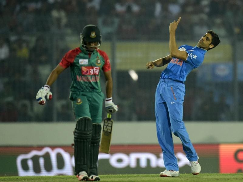Ashish Nehra (R) celebrates the dismissal of Mohammad Mithun (L). (AFP Photo)
