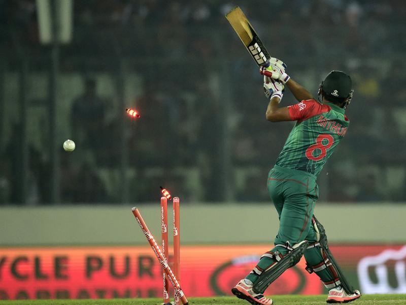 Bangladesh's Mohammad Mithun is bowled by Nehra. (AFP Photo)