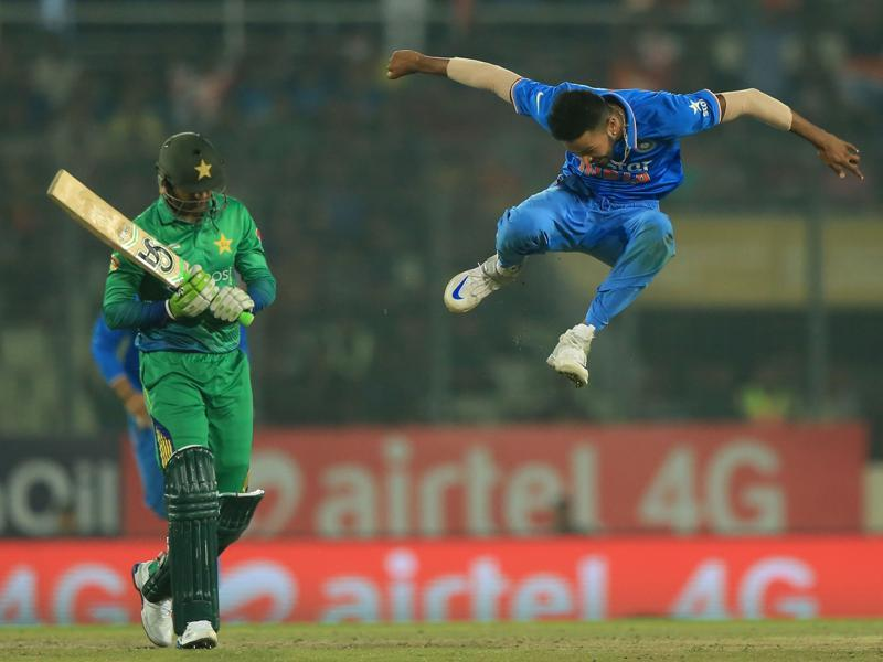 India's Hardik Pandya (R) jumps in the air in celebration after his dismissal of Shoaib Malik. (AFP Photo)