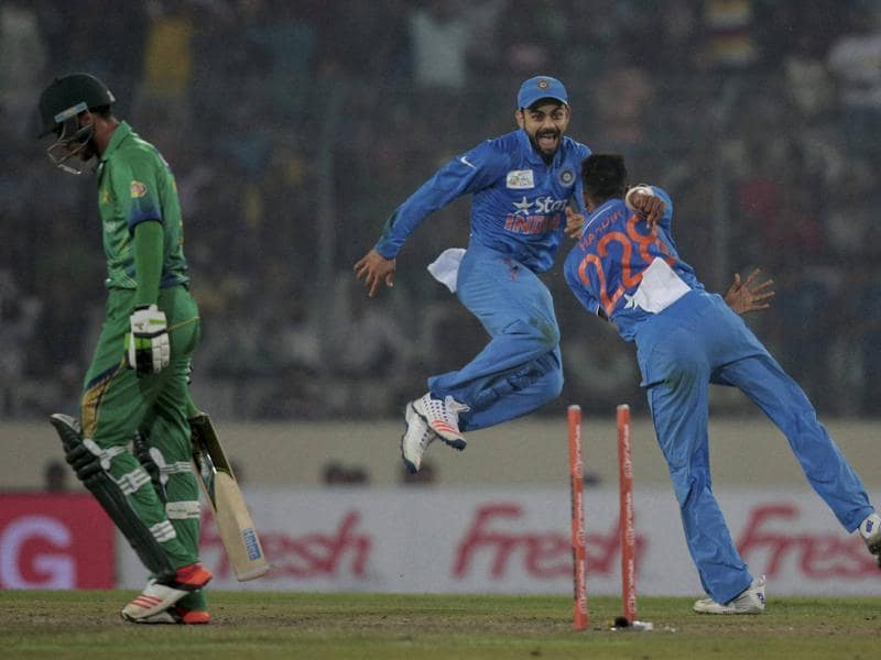 Hardik Pandya, right, celebrates with Virat Kohli, center, after the dismissal of Mohammad Amir, left. (AP Photo)