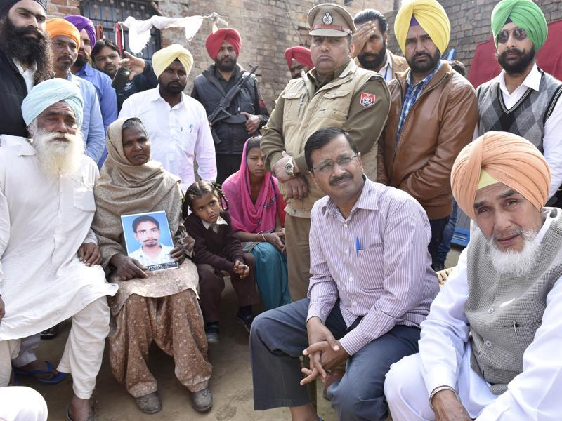 Harike, India – February 27 ::: Arvind Kejriwal Delhi chief minister and AAP convener alone with AAP leader from Punjab interacting with family members of deceased Jasbir Singh a drug addicted at thier village Harike of Tran Taran District, on Saturday, February 27, 2016. Photo by Gurpreet Singh/Hindustan Times
