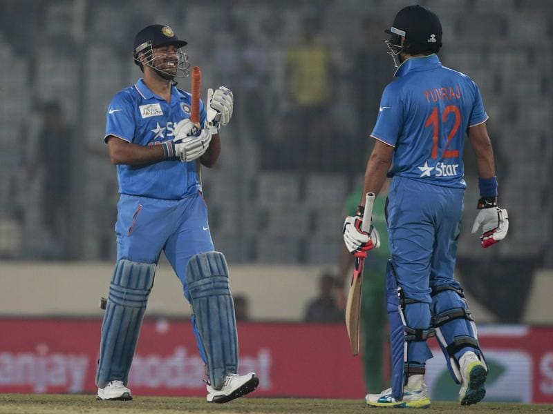 India's captain Mahendra Dhoni and Yuvraj Singh celebrate after winning the Asia Cup Twenty20 international cricket match against Pakistan. (AP Photo)