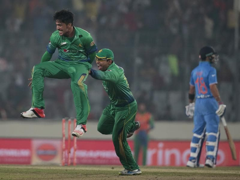 Mohammad Amir, left, after the dismissal of Raina. (AP Photo)