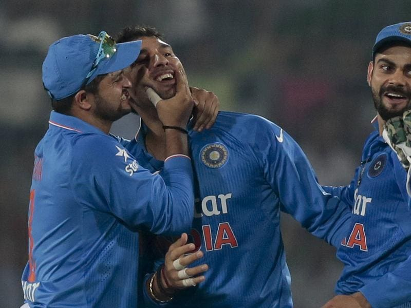 Yuvraj Singh, center, celebrates with Suresh Raina, left, and Virat Kohli after the dismissal of Pakistan's Umar Akmal. (AP Photo)