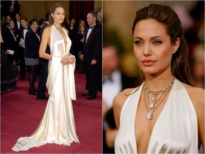 Angelina Jolie was hotter than ever in this plunging white silk Marc Bouwer gown in 2004. (Pinterest)